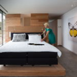 luxury bedroom in wood with butterflies in begur costa brava